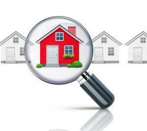 magnifying glass over a house